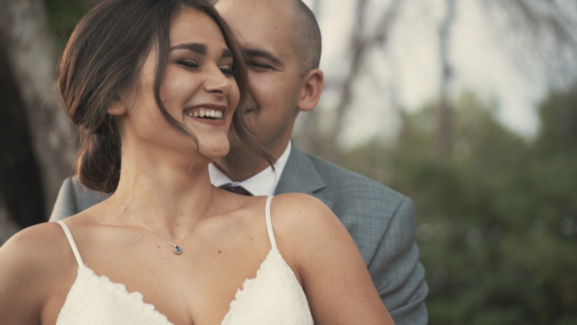 Beautiful bride and groom under umbrella on wedding day - minimalist, artsy shot.
