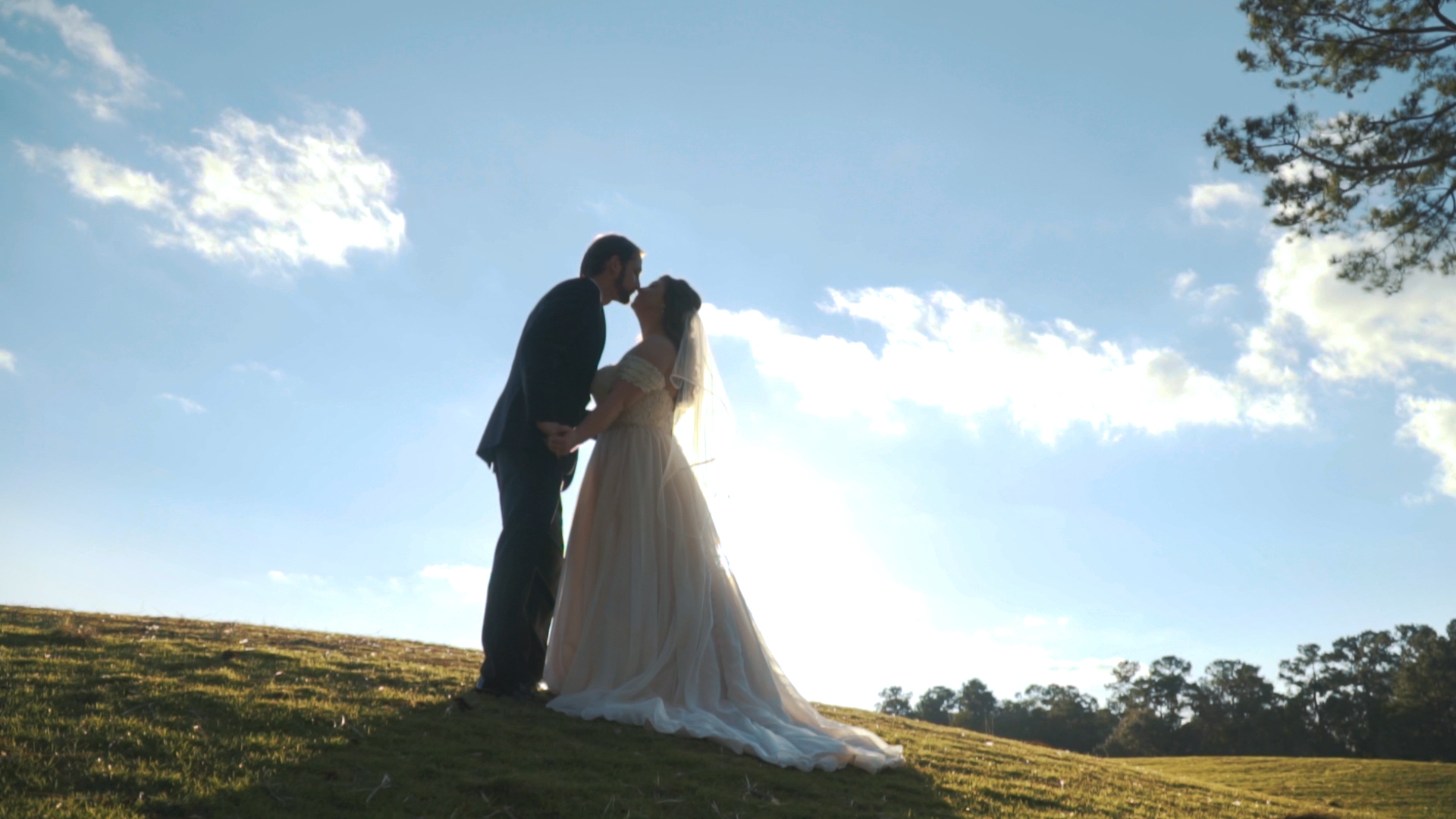 Bride and groom hold hands and read letters to one another during first touch on wedding day.
