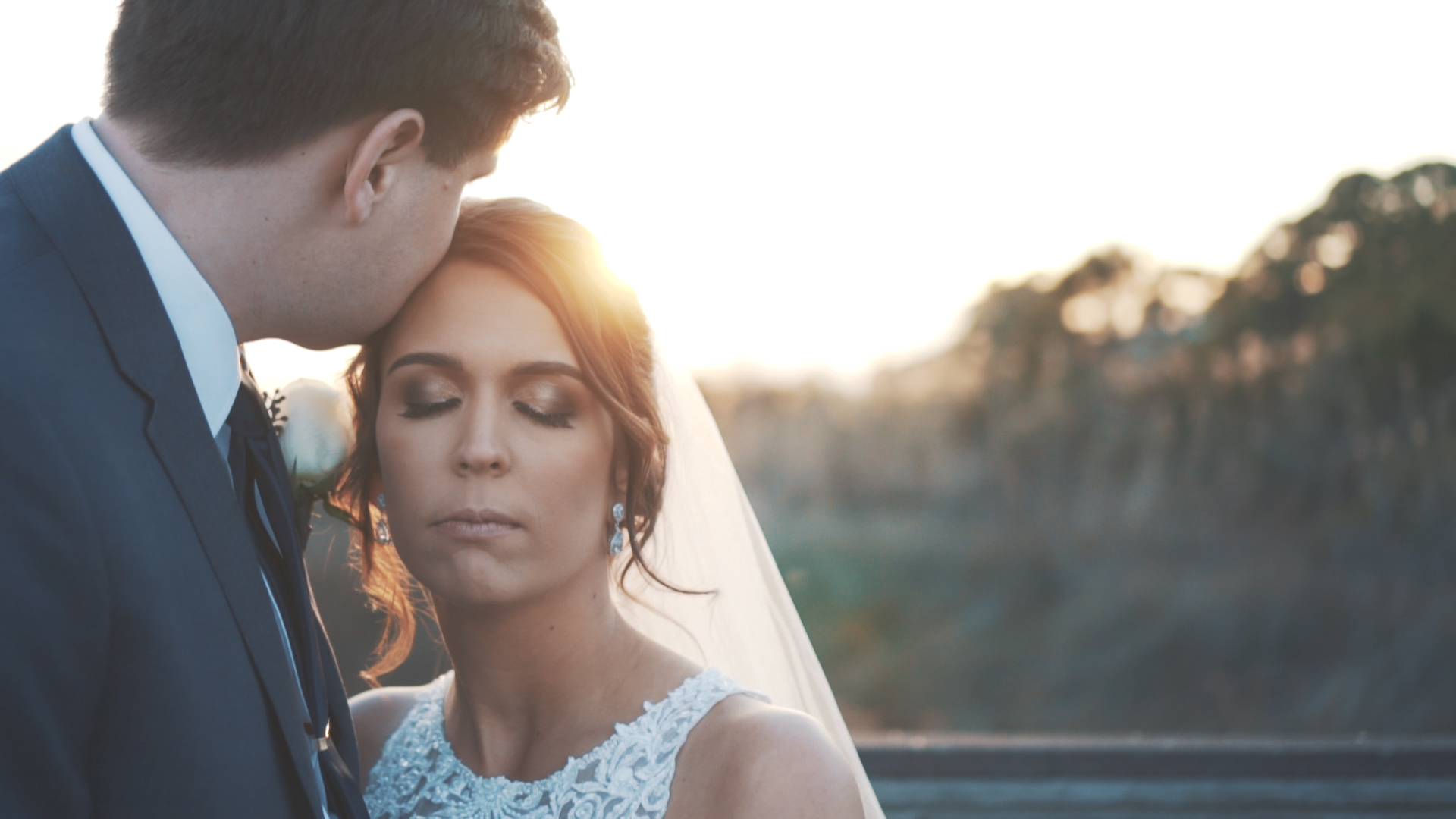 Bride and groom embrace  at sunset on the Florida coast.
