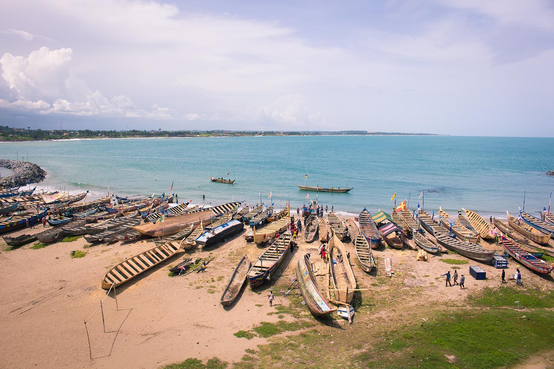 busy clean beach fishermen ghana