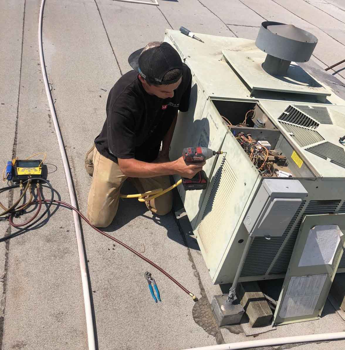 technician working on the roof