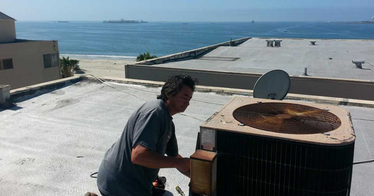 replacing and AC on a roof