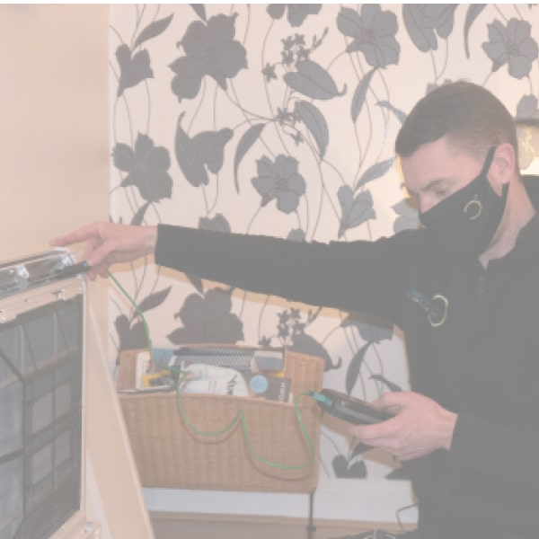 engineer servicing air conditioning