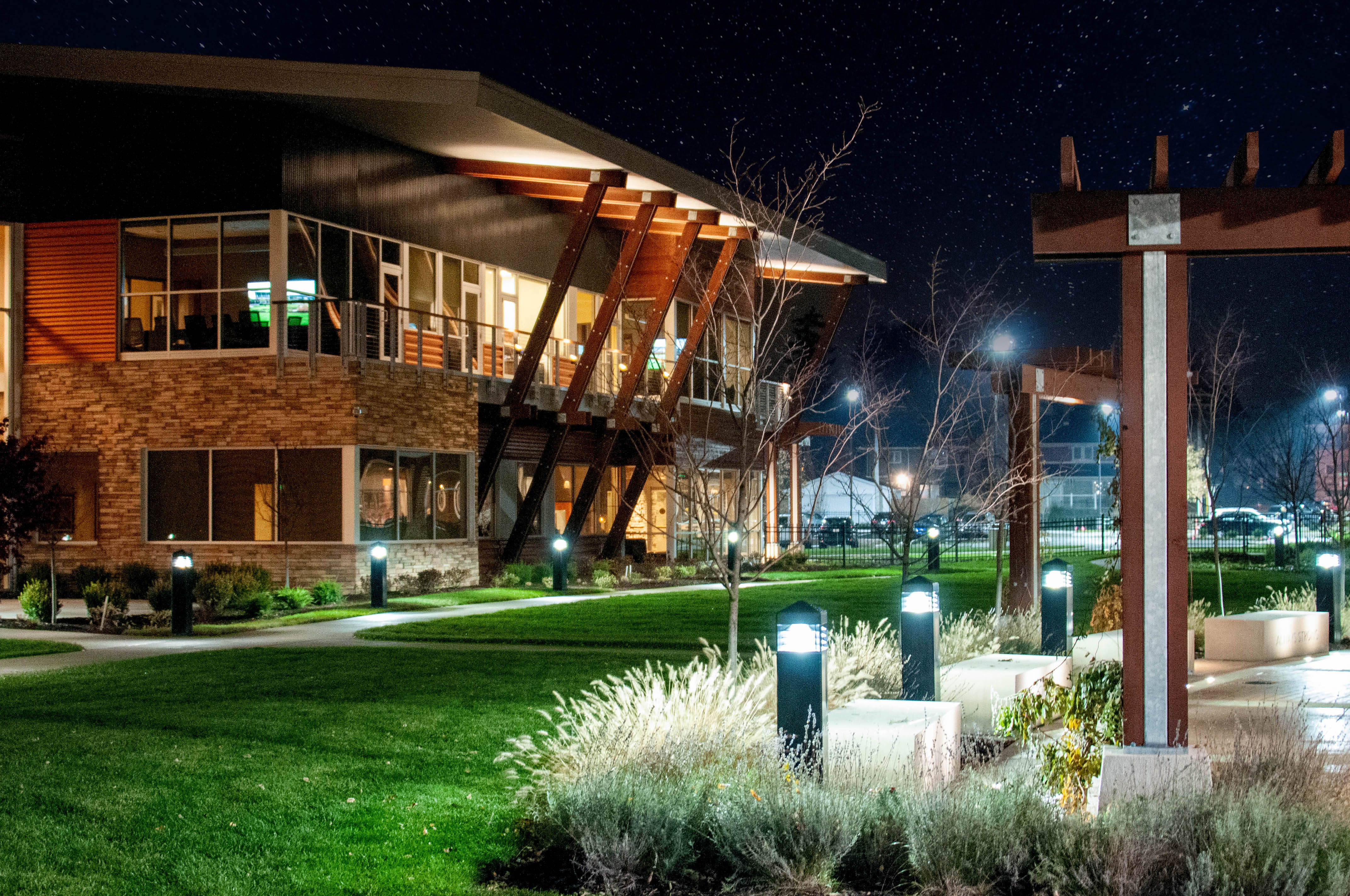 Mishawaka Indiana Center for Hospice at night looking into their garden area.