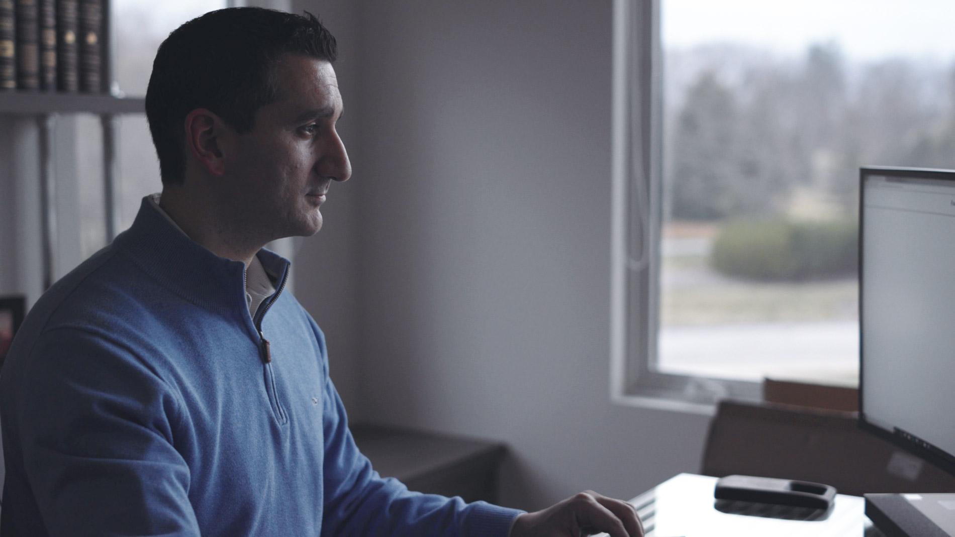 Moe Working On Computer