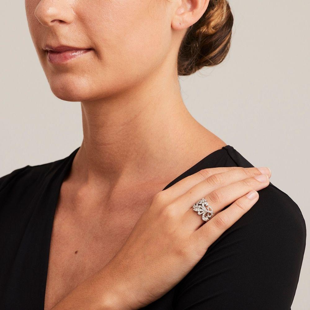 Beautiful Fleur de Lys Diamond ring on model's hand