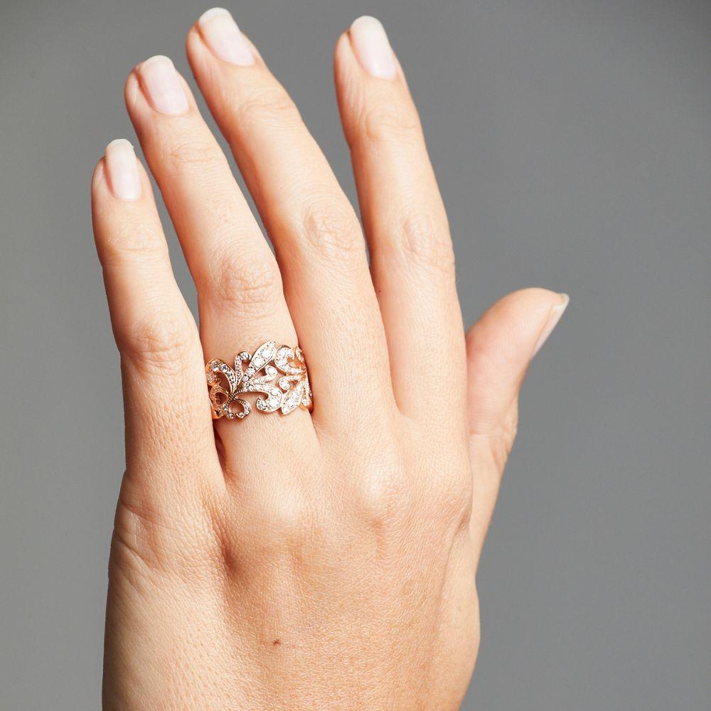 Rose gold Fleur de Lys Diamond Ring on hand