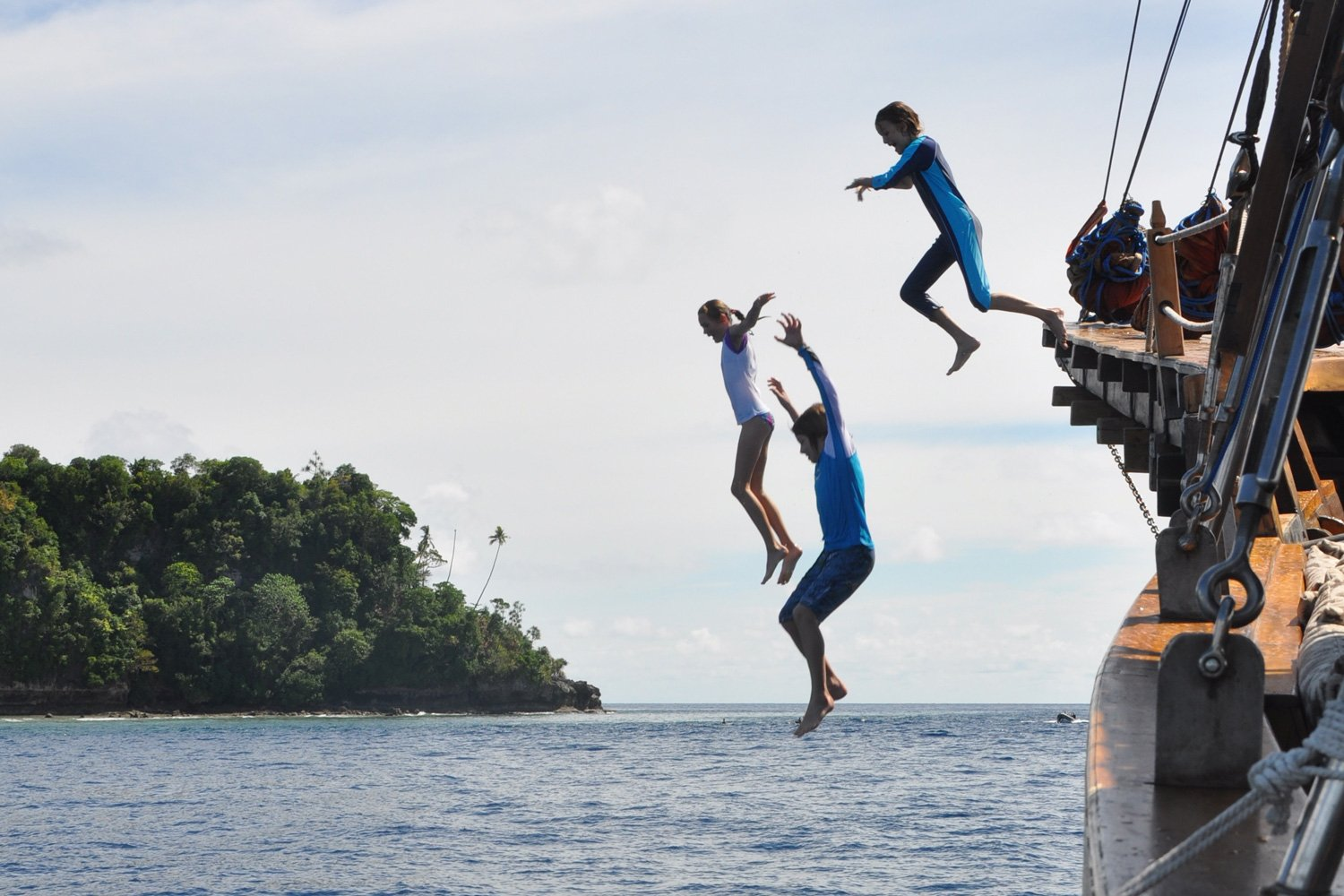 Kids jumping off the bow of Tiger Blue into the sea