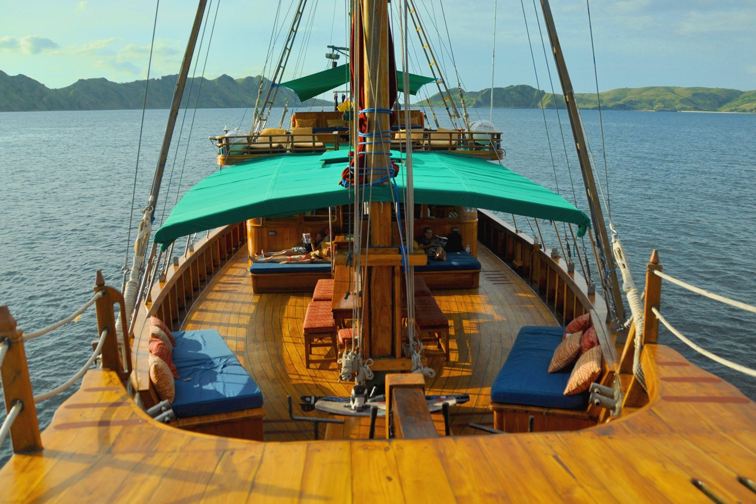 Relax on a daybed on the main deck as Tiger Blue sails the seas of Eastern Indonesia