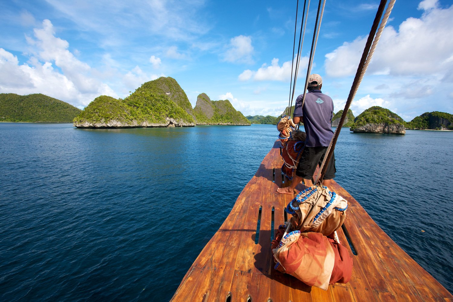 Crew member at front as Tiger Blue enters Raja Ampat