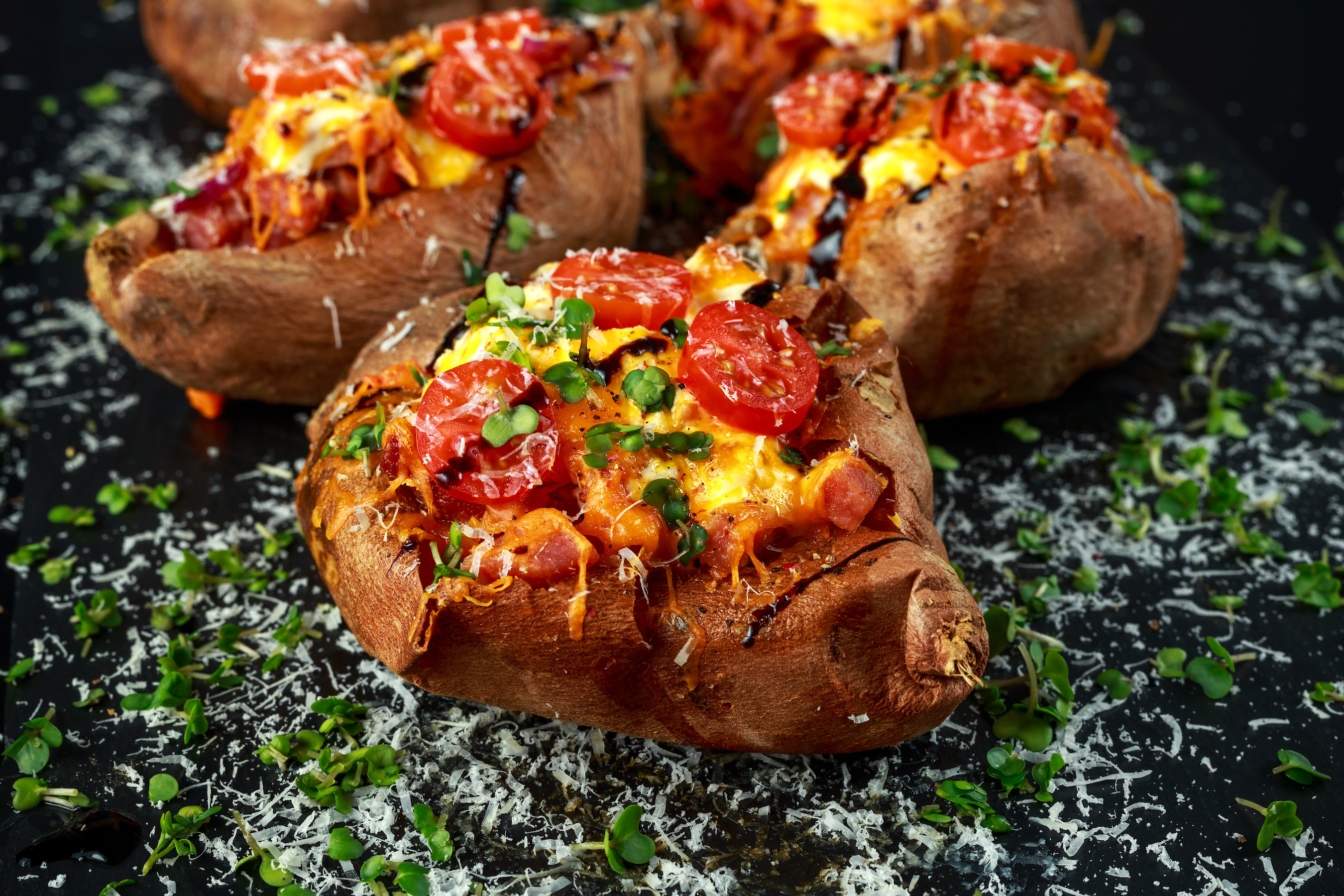 Bacon, tomato and cheese stuffed jacket sweet potato
