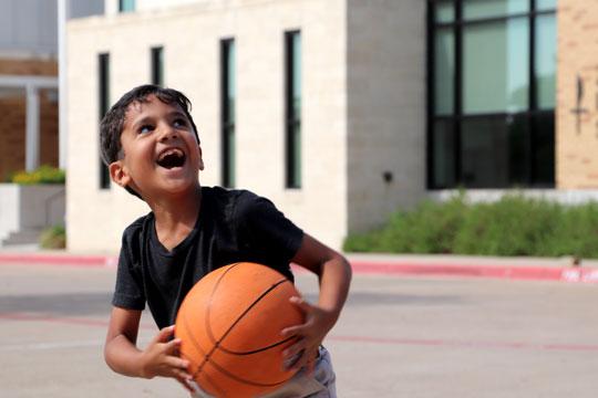 Child playing basketball