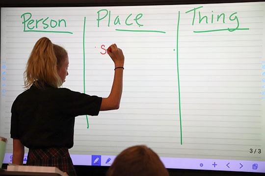 Student writing digitally