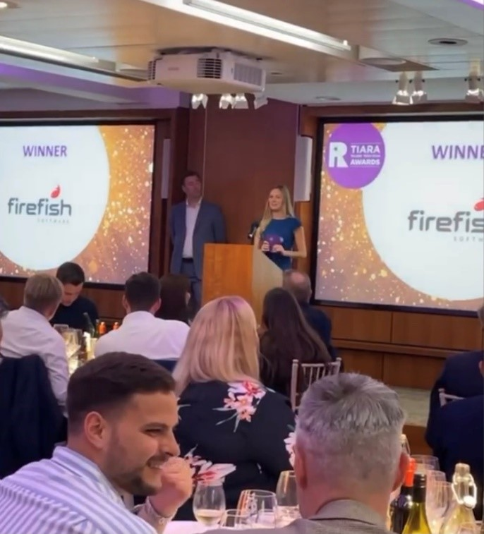 Firefish's Beth accepts the award
