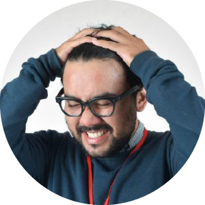 Employee with his hands on his head. Appearing stressed out.