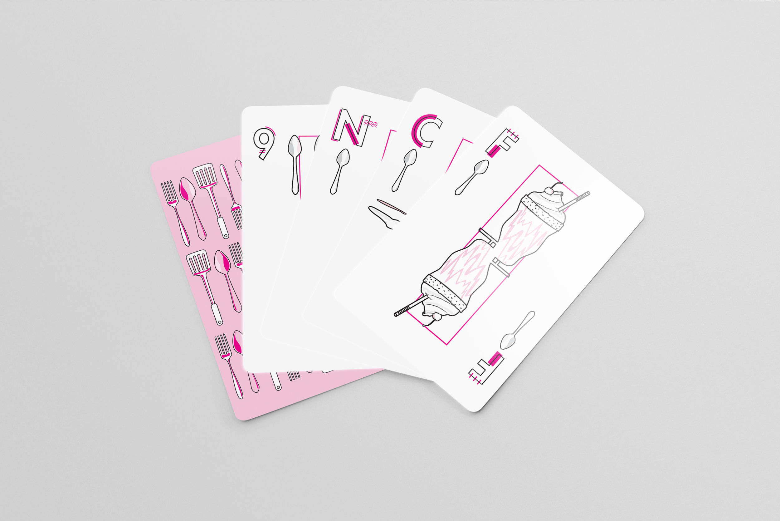 5 cards laid out in a fan shape to show off the traits of a playing card deck. It shows, from left to right, the back of the card, the number card 9, the 'neutral' face card, the 'clumsy' face card, and the 'friendly' face card