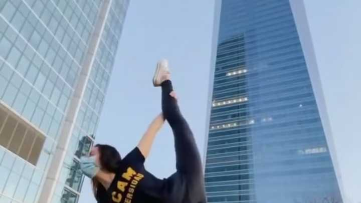 Student in a big city doing yoga