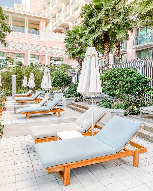 Pool area of a resort hotel with lounges and umbrellas