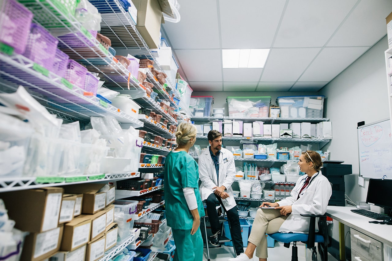 medical professionals conversing in hospital storage room office