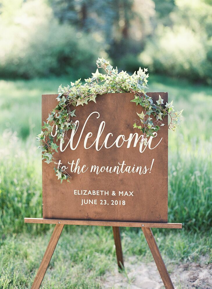 Rustic Wood Welcome Sign with Greenery
