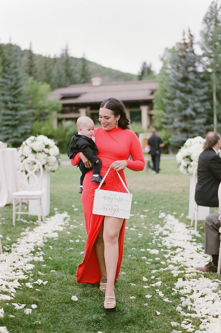 Ring Bearer Being Carried Down Aisle at Colorado Wedding