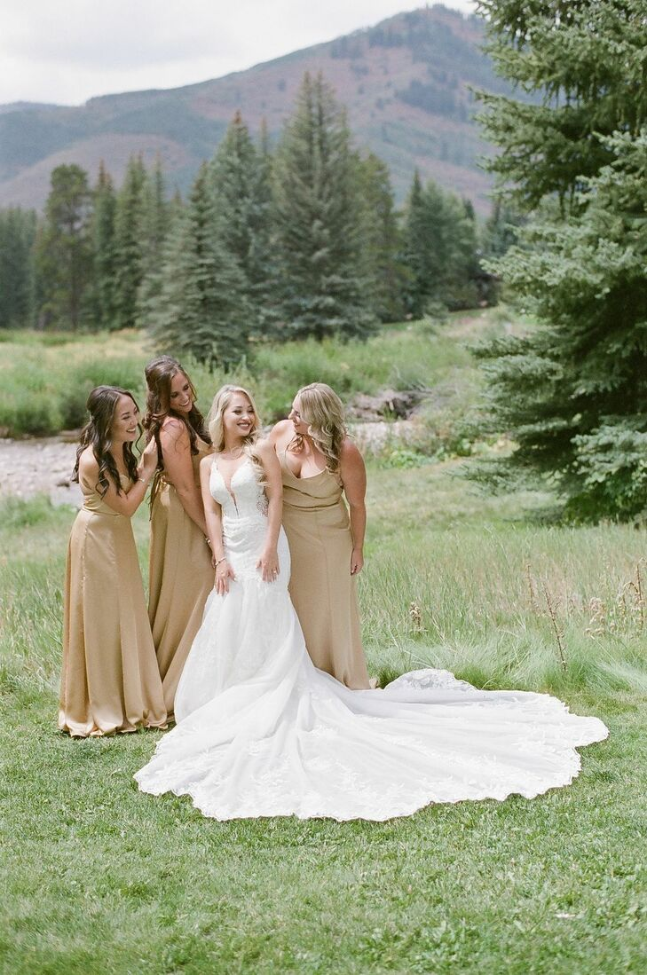 Wedding Party Members in Gold Dresses in Vail, Colorado