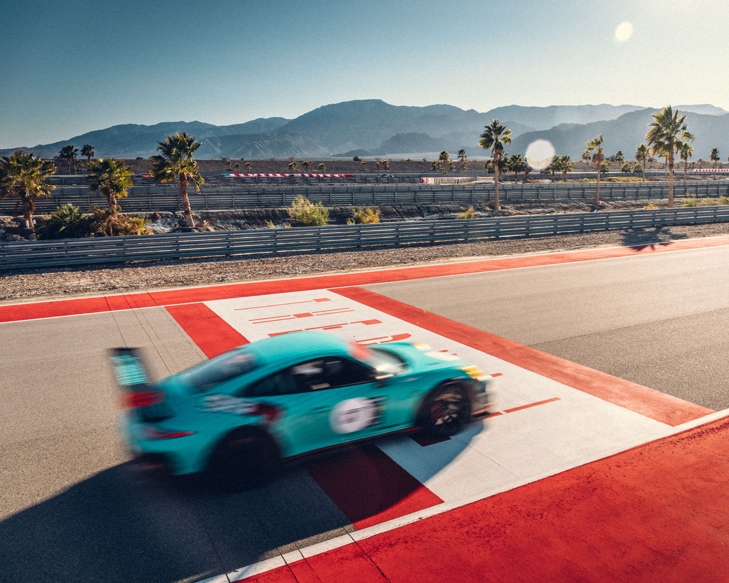 Porsche crossing the finish line at The Thermal Club Photo by Mo Satarzadeh