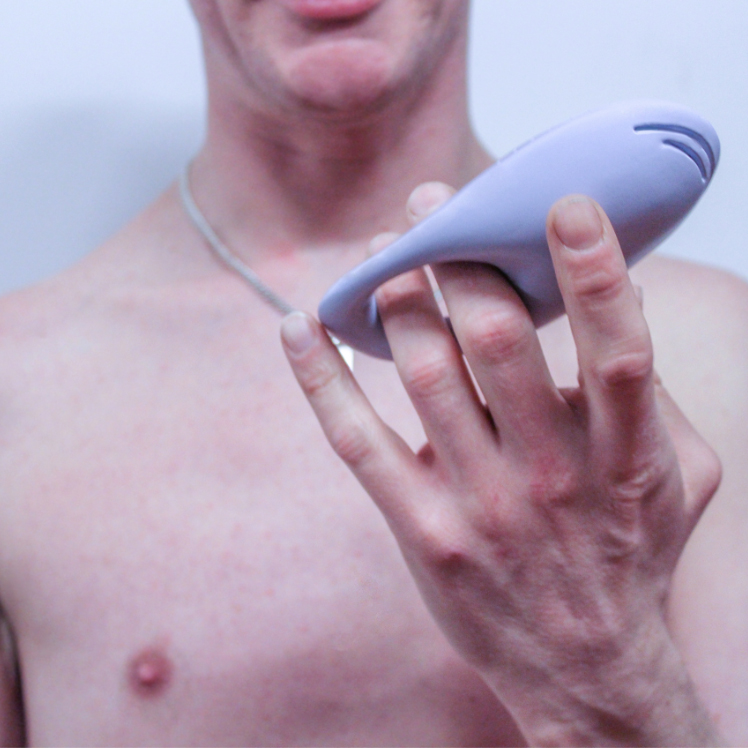 Man holding a sex toy for people with disability