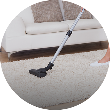 cleaning a carpet with a vacuum