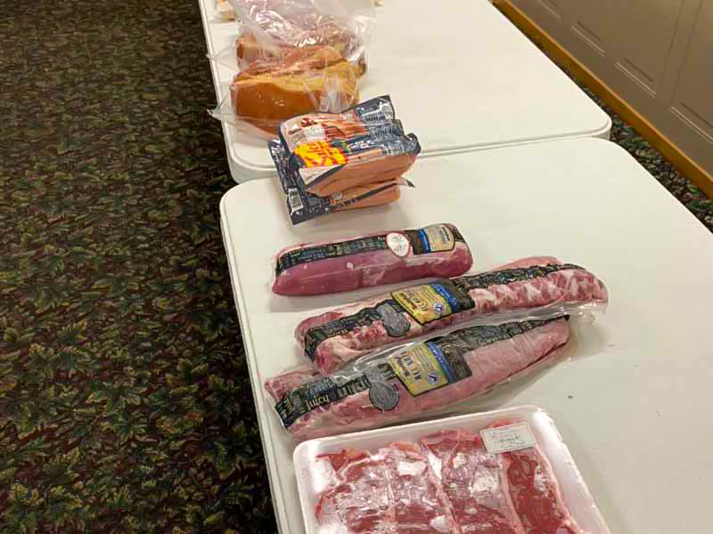 Table with packages of meat