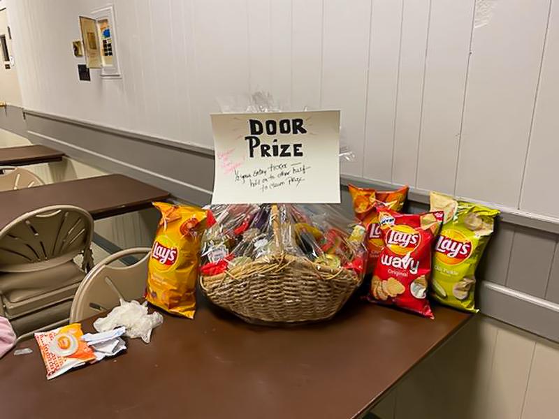 Door prize basket full of bags of chips