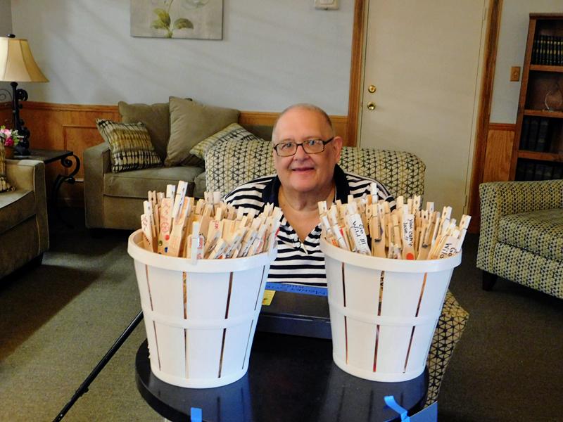 Man sitting behind buckets