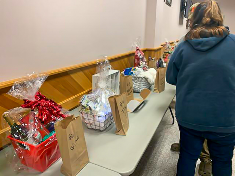 Person looking at prize baskets on table