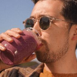 Man enjoying SeaMoss beverage