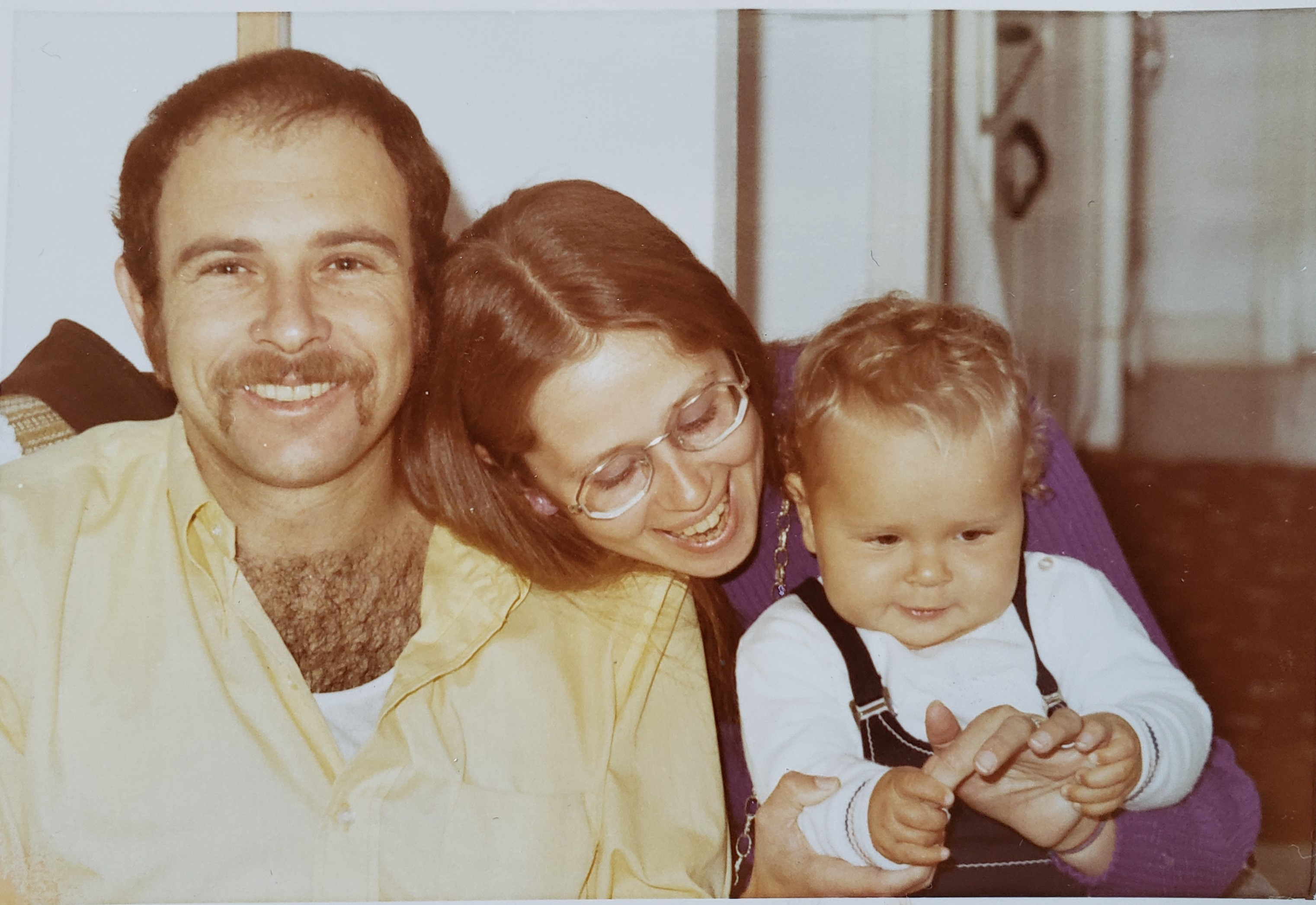 My parents and me. I have no memories of us as a family.