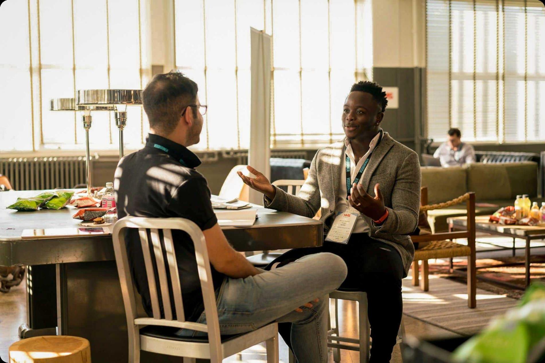2 men talking at a dinner interview recruiting event