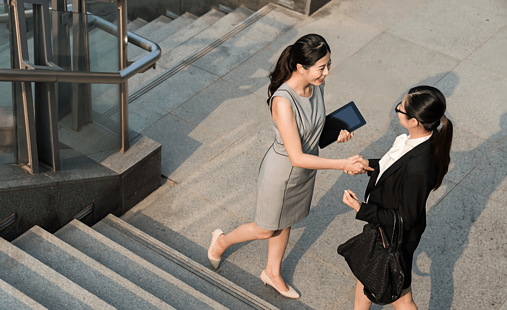 two professional women shaking hands