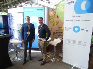 The Onedot Team at the booth, ready for the visitors to come