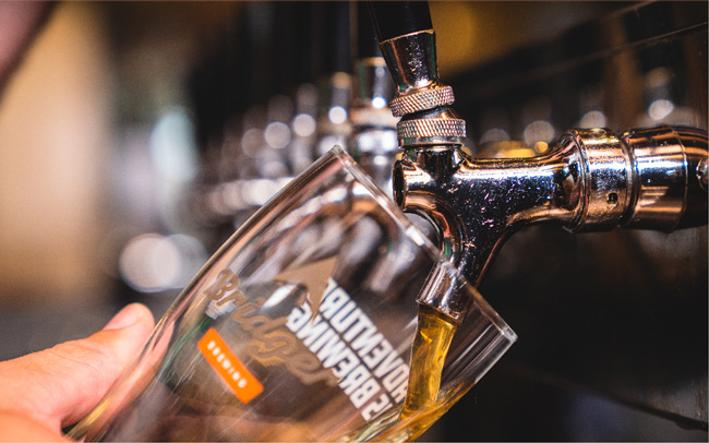 Beer being poured from a tap into a pint glass