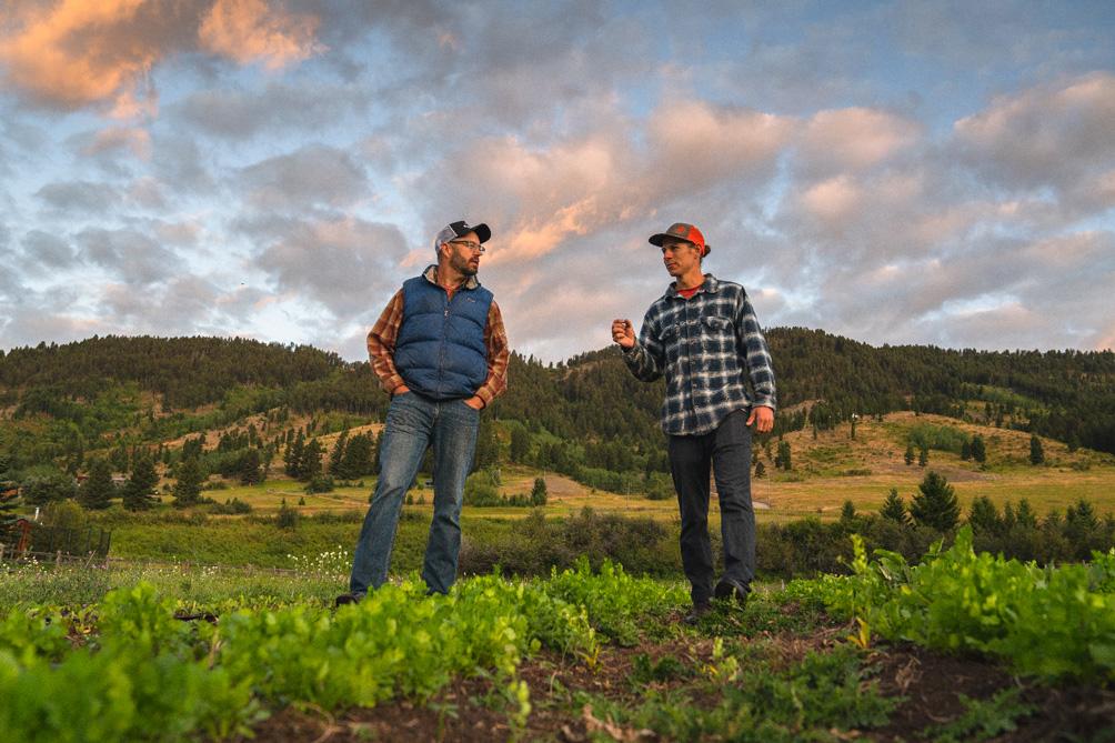 Bridger owner and local farmer chatting at farm