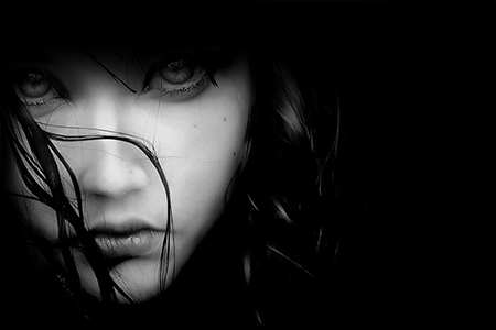 a spiritual woman in the darkness and shadow