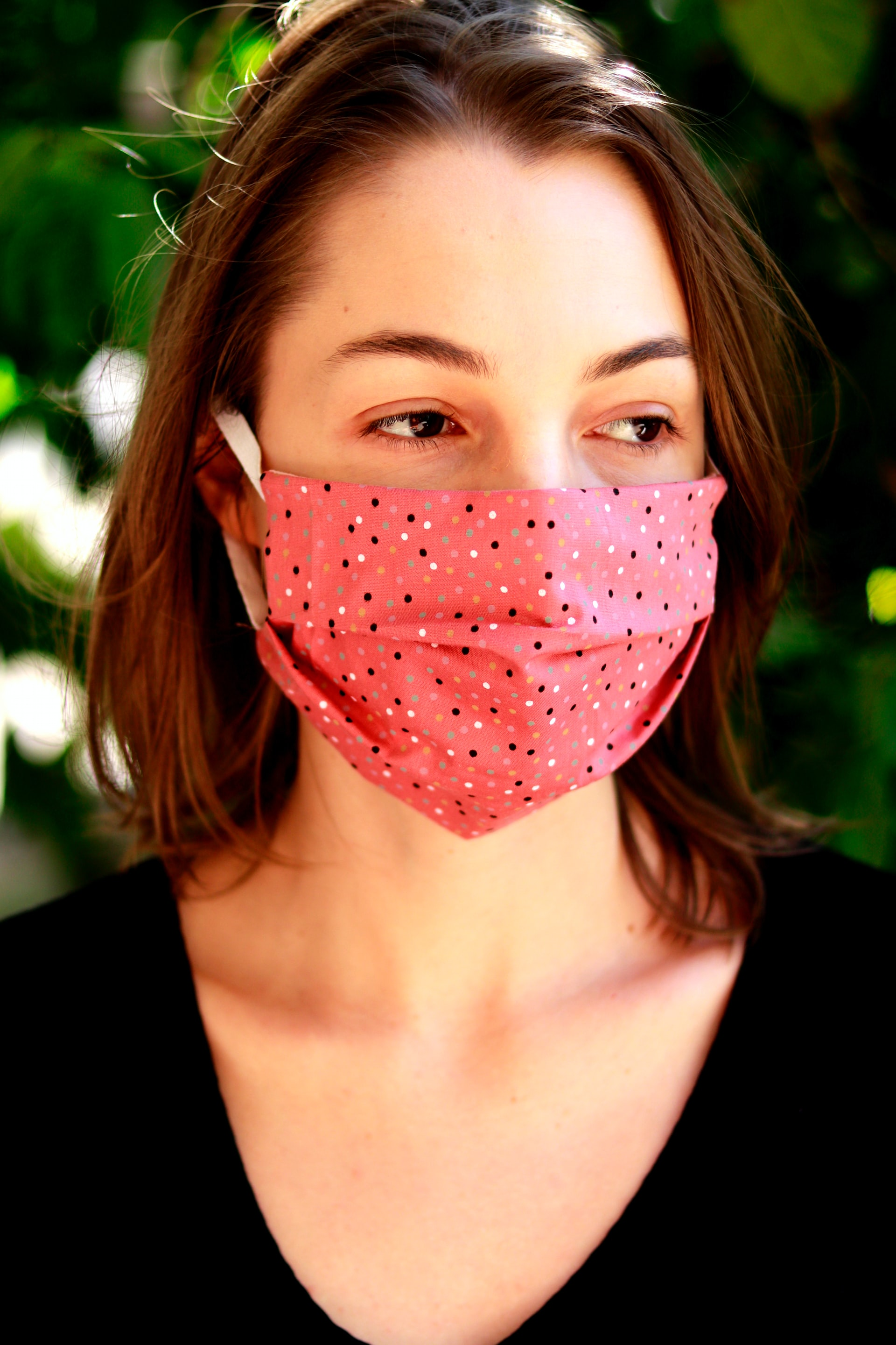 Woman in a face mask amidst COVID-19