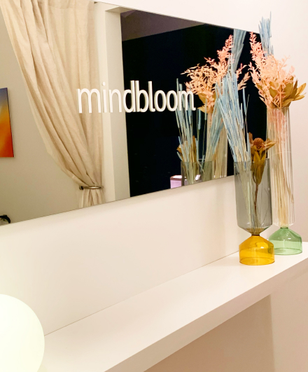 A mirror with Mindbloom's logo on it