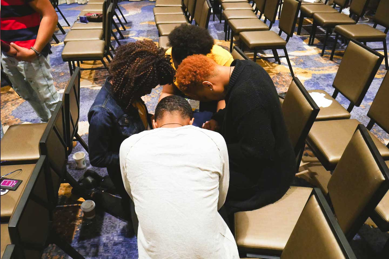 BCM students praying