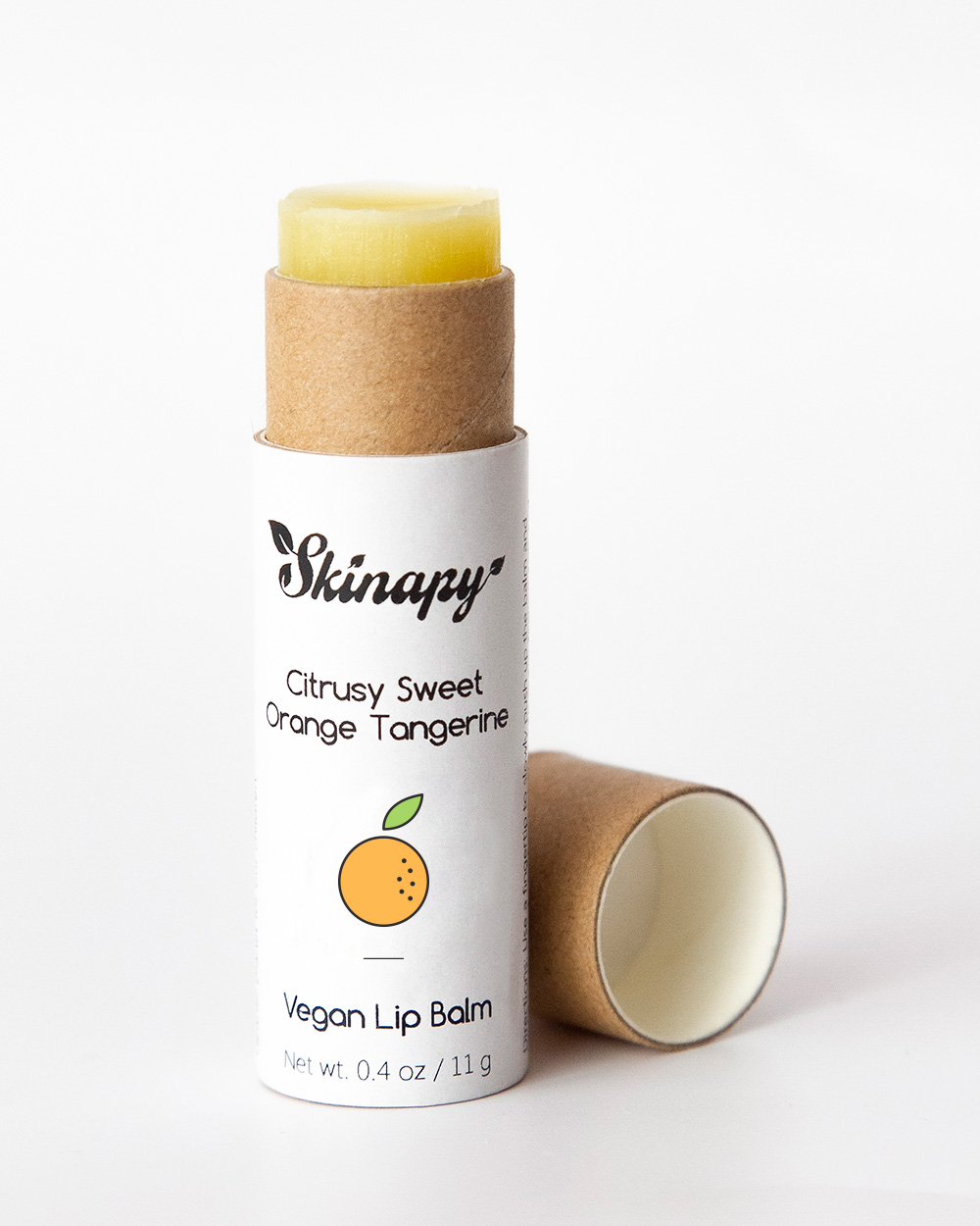 Skinapy natural and organic vegan lip balm with citrus scent packaged in biodegradable paper tube