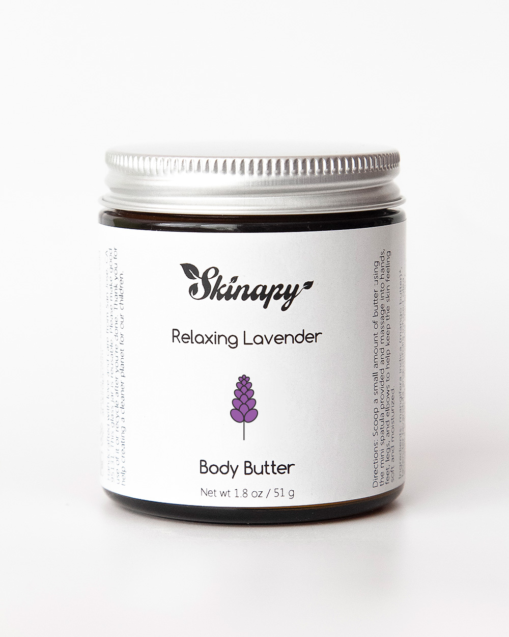 Skinapy natural and organic body butter with lavender scent inside a dark amber glass jar with silver metal aluminum lid