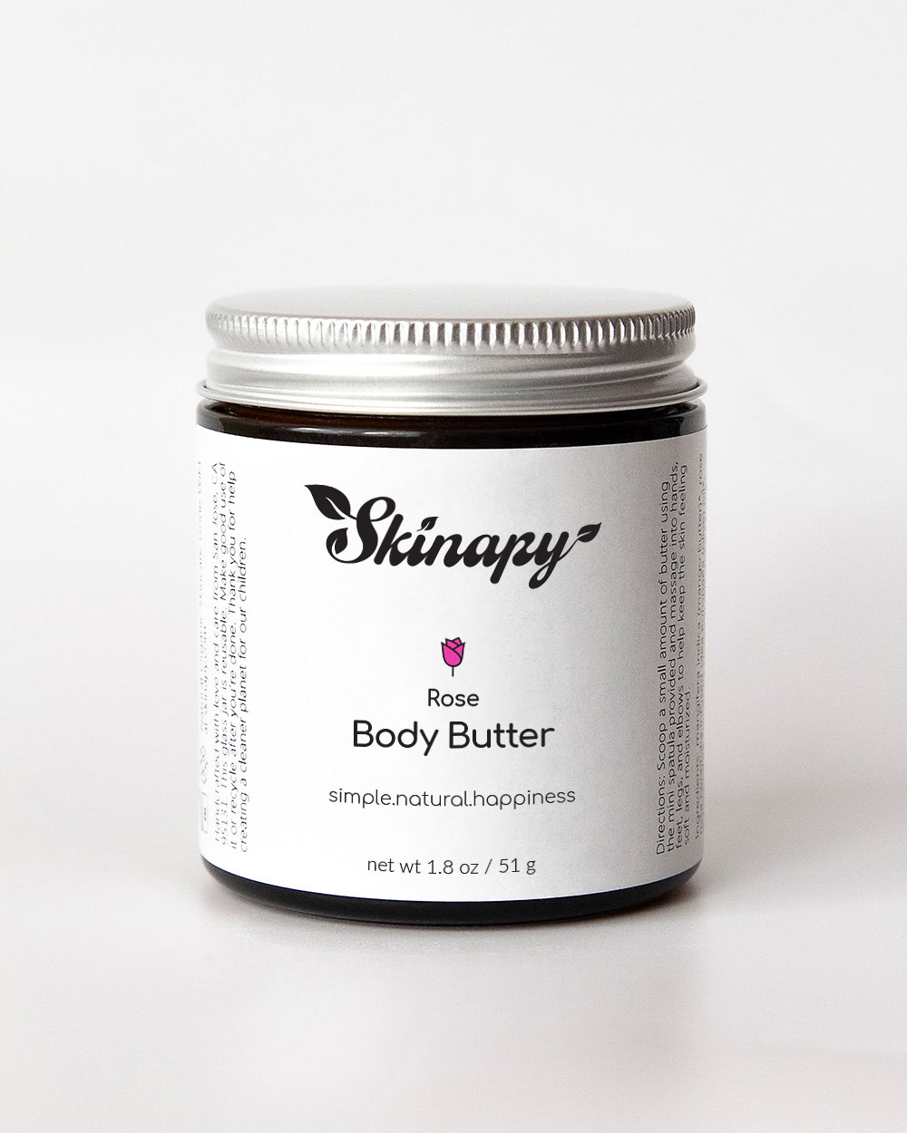 Skinapy natural and organic body butter with rose scent inside a dark amber glass jar with silver metal aluminum lid