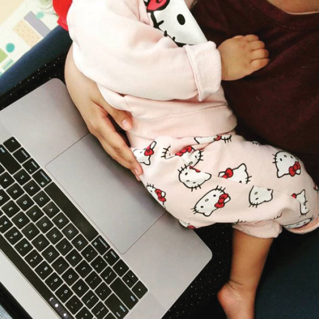 Working mom - Holding baby while on working on my laptop