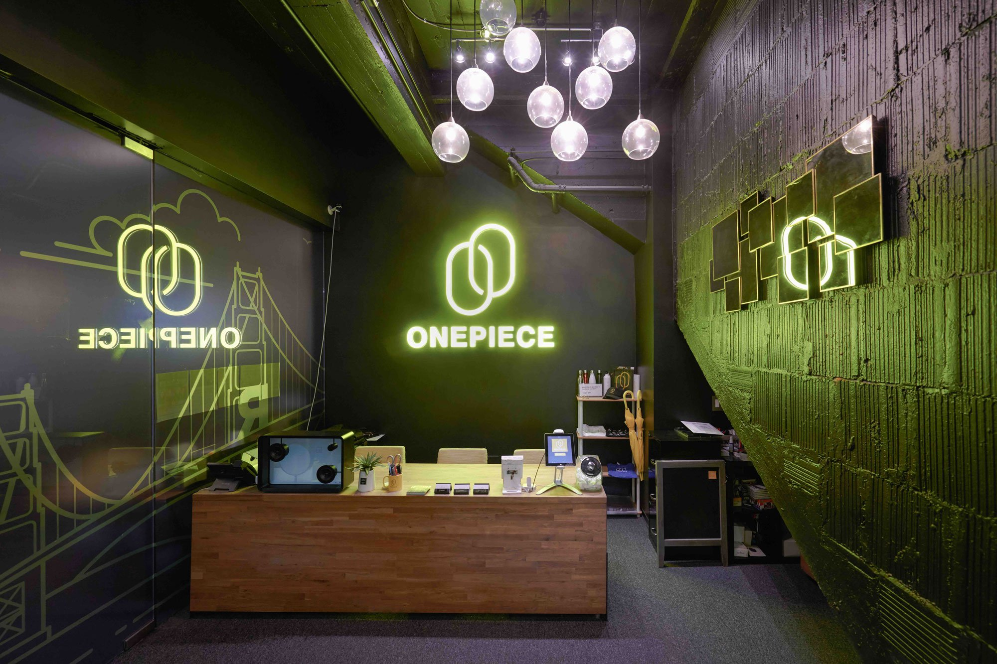 OnePiece Work San Francisco lobby featuring rustic wood finishes, industrial-chic decor, and neon-lit signage