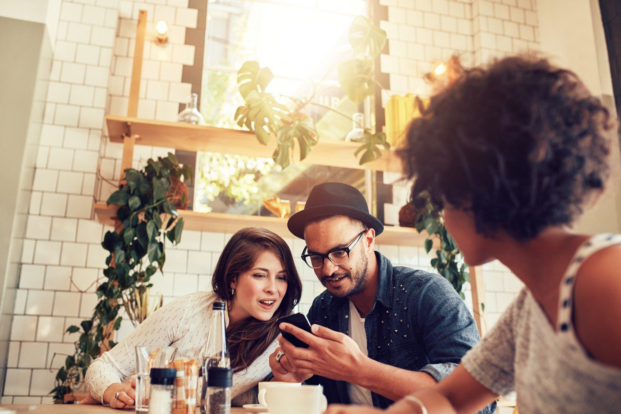 Friends using smartphone in a restaurant